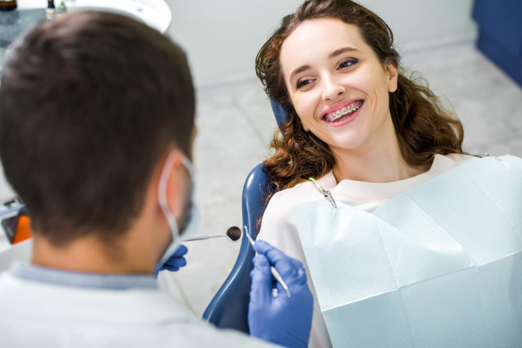 A patient with Traditional Braces in Encinoat the dentist