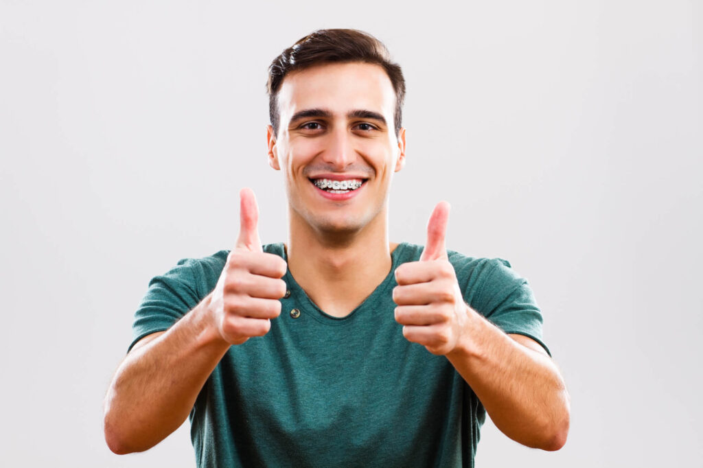 Man with Traditional Braces in Encino smiling and giving a thumbs up